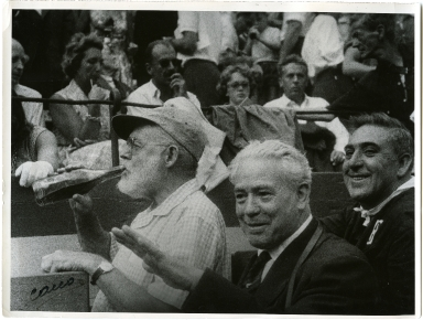 Hemingway Drinking at Bullfight