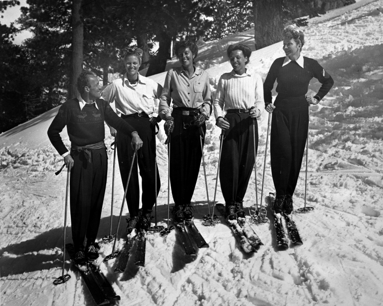 Sigi Engl on skis with friends.
