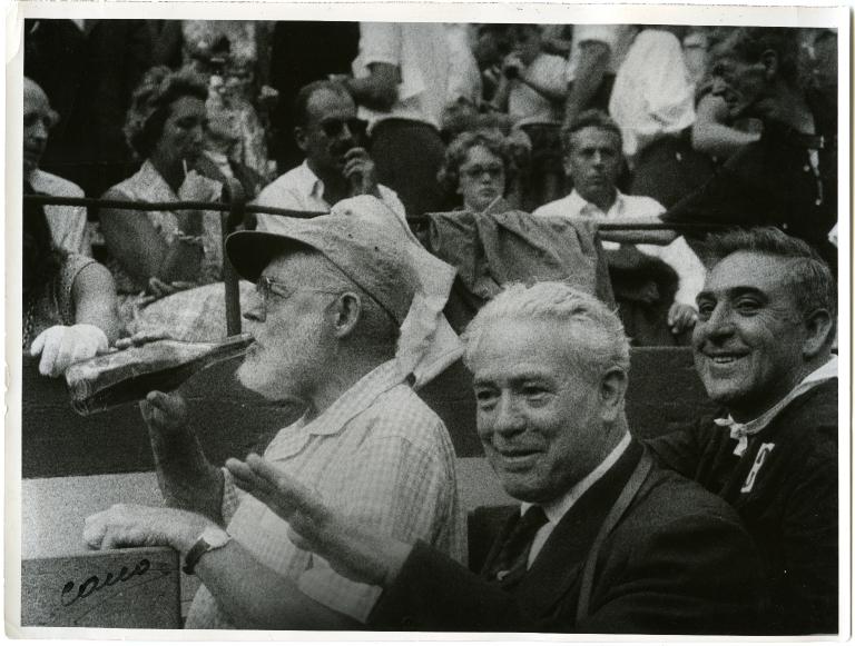 Hemingway Drinking at Bullfight
