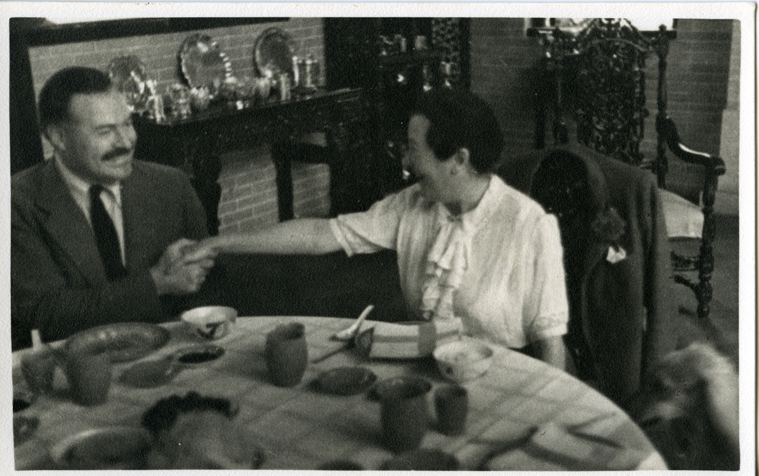 Hemingway at Table with Woman