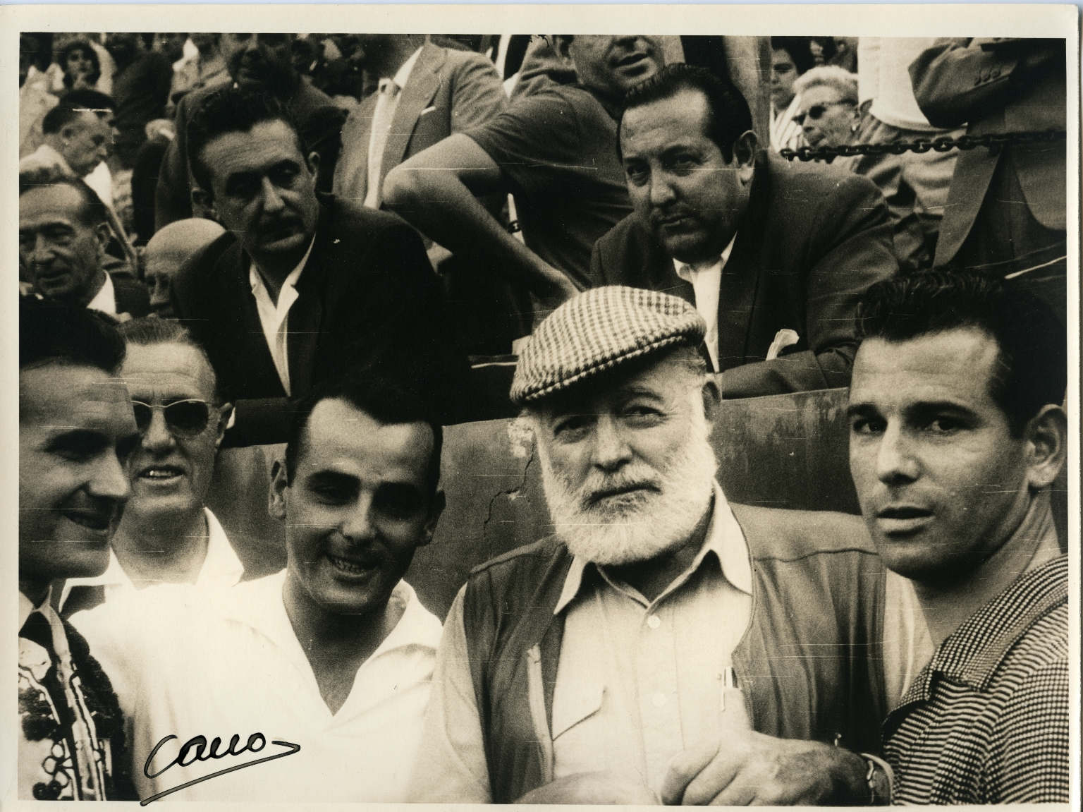 Hemingway at Bullfight in Checkered Cap