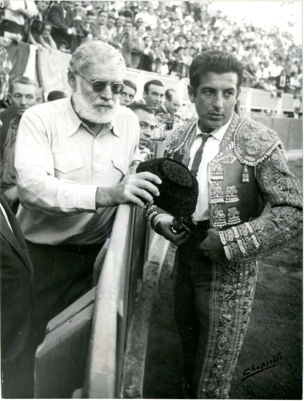 Hemingway and Ordonez Stand at the Edge of the Ring at a Bullfight