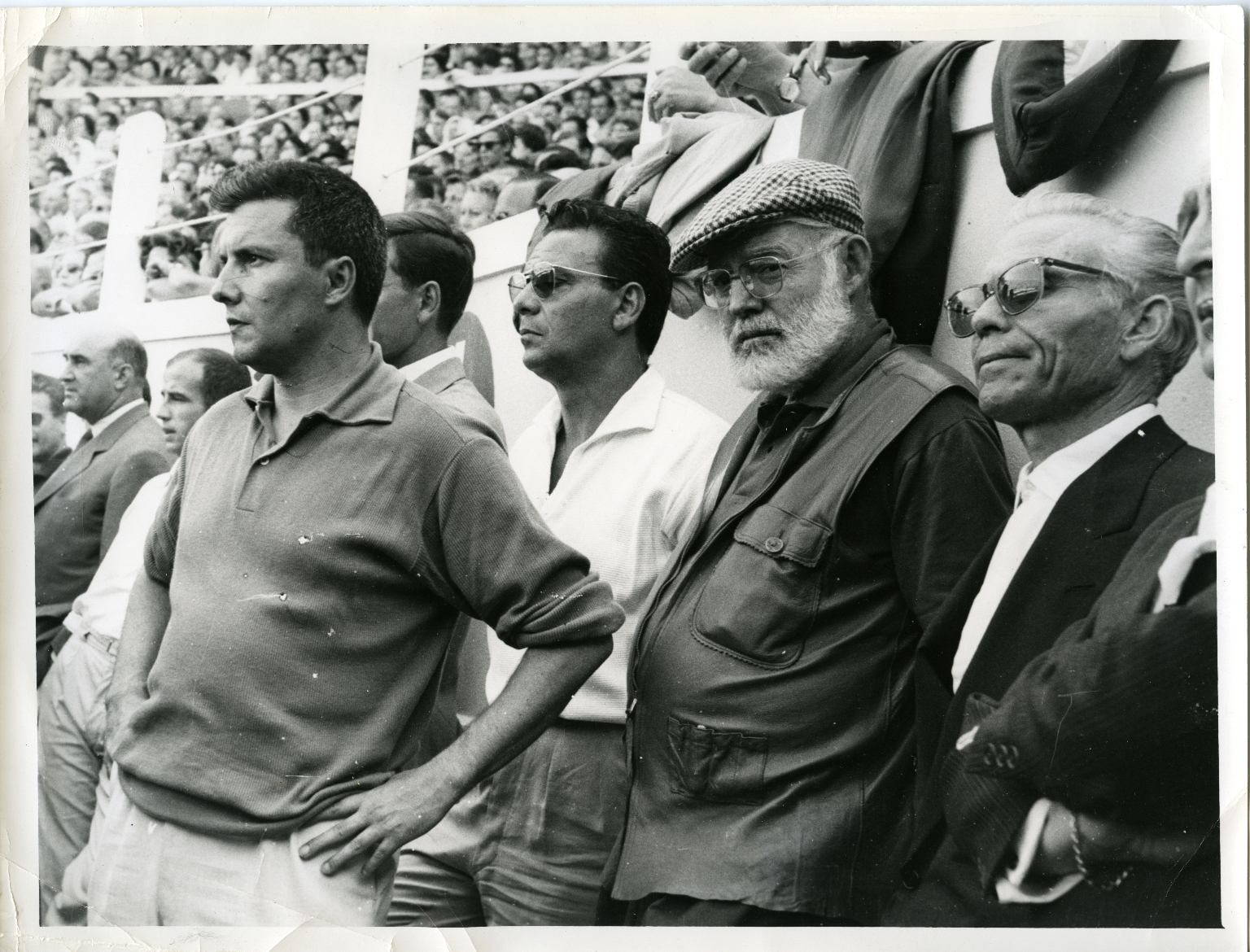 Hemingway in Jacket and Checkered Cap at Bullfight