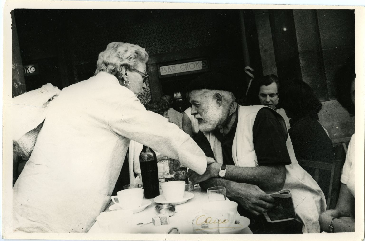 Hemingway Seated at Spanish Restaurant, Holding Hands with Woman